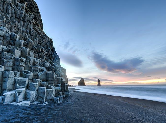 <p>Iceland could basically be on another planet. Just look at this black sand beach framed by basalt columns near the village of Vik on the country's south coast.</p>