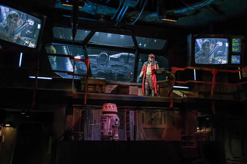 The notorious Weequay pirate Hondo Ohnaka, accompanied by his astromech R5-P8, gives guests their mission prior to boarding Millennium Falcon: Smugglers Run. (Richard Harbaugh/Disney Parks)