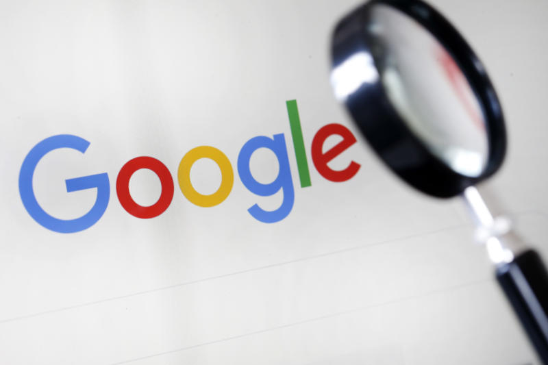 PARIS, FRANCE - SEPTEMBER 10: In this photo illustration, the Google logo is displayed on the screen of a computer next to a magnifying glass on September 10, 2019 in Paris, France. Yesterday in Washington, DC, fifty state attorneys general are joining together announced the launch of an antitrust investigation against the Google company, accused of dominating all aspects of advertising and Internet search. (Photo by Chesnot/Getty Images)