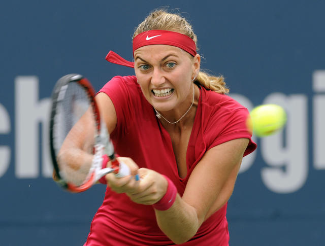 Petra Kvitova, of the Czech Republic, hits a backhand during a quarterfinal match against compatriot Barbora Zahlavova Strycova at the New Haven Open tennis tournament in New Haven, Conn., on Thursday, Aug. 21, 2014. (AP Photo/Fred Beckham)