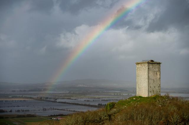 A rainbow is pictured over flooded fields in Xinzo de Limia following heavy rains. (Getty)