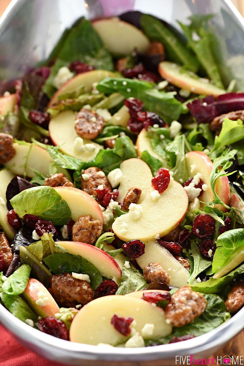 """<p>This hearty salad, made with Honeycrisp apple slices, crunchy candied pecans, chewy dried cranberries, salty blue cheese, and a tangy-sweet apple cider vinaigrette, is the perfect fuel for holiday festivities.</p><p><strong>Get the recipe at <a href=""""https://www.fivehearthome.com/holiday-honeycrisp-salad/#_a5y_p=4564774"""" rel=""""nofollow noopener"""" target=""""_blank"""" data-ylk=""""slk:Five Heart Home"""" class=""""link rapid-noclick-resp"""">Five Heart Home</a>.</strong></p>"""