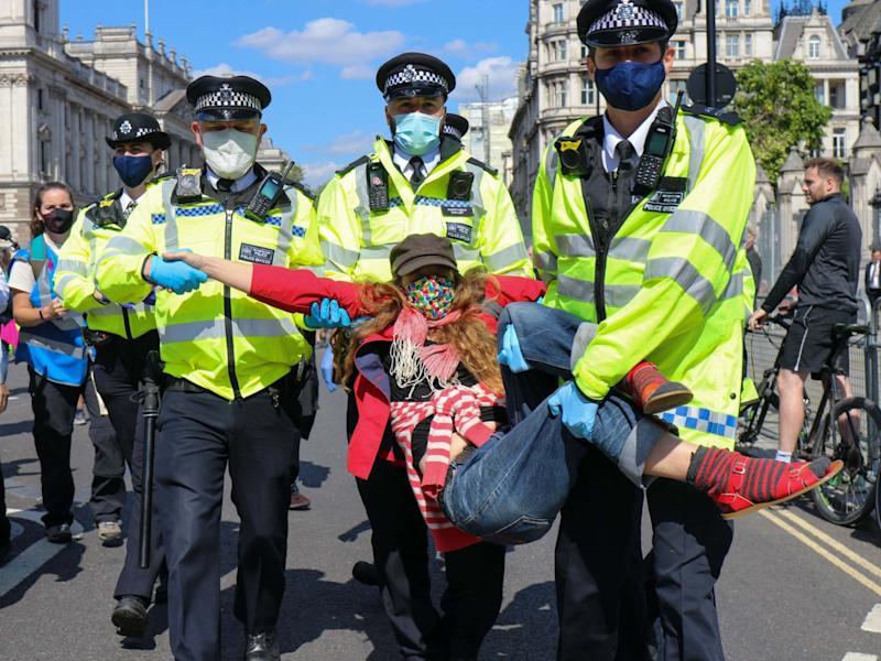 XR activist led away by police near Parliament Square: Lucy North/MI News
