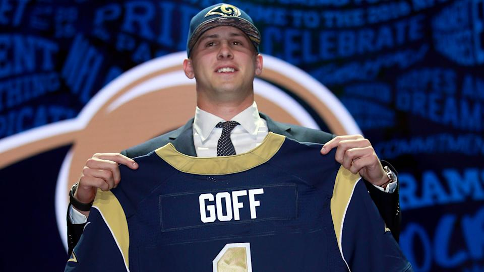 Mandatory Credit: Photo by Jeff Haynes/AP/Shutterstock (9269123bj)California's Jared Goff poses for photos after being selected by the Los Angeles Rams as the first pick in the first round of the 2016 NFL football draft, in Chicago2016 NFL Draft, Chicago, USA - 28 Apr 2016.