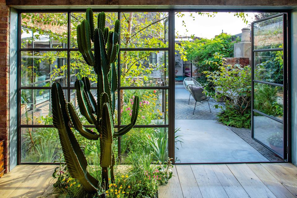 <p>Holding court: garden designer Martha Krempel has used every inch of her garden to create a spacious yet intimate feel</p> (Clive Nichols)
