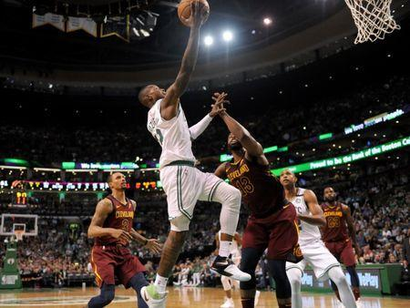 May 15, 2018; Boston, MA, USA; Boston Celtics guard Terry Rozier (12) attempts a layup against the Cleveland Cavaliers during the third quarter in game two of the Eastern conference finals of the 2018 NBA Playoffs at TD Garden. Mandatory Credit: Bob DeChiara-USA TODAY Sports