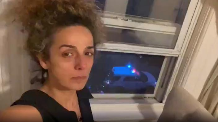 Iranian-American journalist Alinejad Masih shows an FBI car guarding outside her apartment in this still image from an undated social media video posted on July 14, 2021. (Twitter/@ALINEJADMASIH via Reuters)