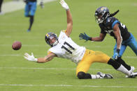 Pittsburgh Steelers wide receiver Chase Claypool (11) tries but can't make a reception in front of Jacksonville Jaguars cornerback Chris Claybrooks during the first half of an NFL football game, Sunday, Nov. 22, 2020, in Jacksonville, Fla. (AP Photo/Matt Stamey)