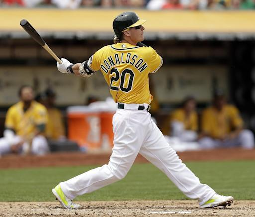 Oakland Athletics' Josh Donaldson hits an RBI sacrifice fly off Baltimore Orioles' Kevin Gausman in the fourth inning of a baseball game Sunday, July 20, 2014, in Oakland, Calif. (AP Photo/Ben Margot)