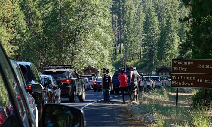 A line of cars backed up at the Big Oak Flat entrance as visitors arrive for the Fourth of July weekend in Yosemite national park.