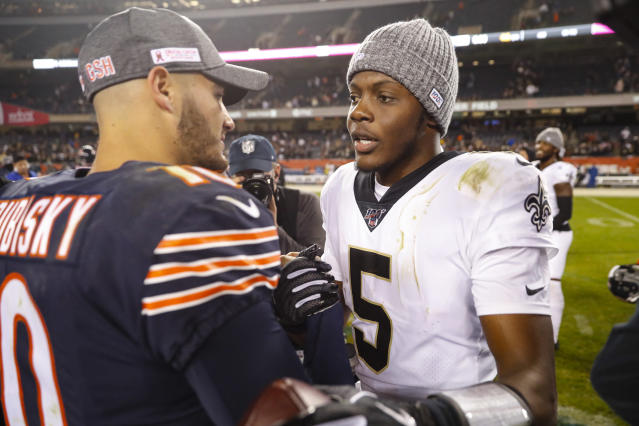 Chicago Bears quarterback Mitchell Trubisky (10) meets with New Orleans Saints quarterback Teddy Bridgewater (5) following an NFL football game in Chicago, Sunday, Oct. 20, 2019. The Saints defeated the Bears 36-25. (AP Photo/Charles Rex Arbogast)
