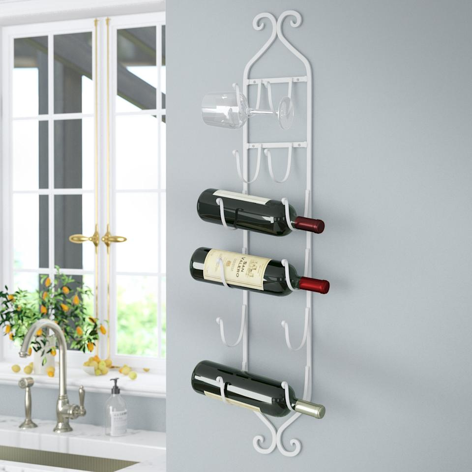 "<h3><a href=""https://www.wayfair.com/kitchen-tabletop/pdp/august-grove-mossley-6-bottle-wall-mounted-wine-bottle-and-glass-rack-aggr2562.html"" rel=""nofollow noopener"" target=""_blank"" data-ylk=""slk:August Grove Mossley Mounted Wine Bottle and Glass Rack"" class=""link rapid-noclick-resp"">August Grove Mossley Mounted Wine Bottle and Glass Rack</a></h3><br><strong>When a bar cart is too big (but so is your booze collection): </strong>Try going with a wall-mounted bar instead that will display your bottles (and glasses) in elevated style.<br><br><strong>August Grove</strong> 6 Bottle Wall Mounted Wine Bottle and Glass Rack, $, available at <a href=""https://go.skimresources.com/?id=30283X879131&url=https%3A%2F%2Fwww.wayfair.com%2Fkitchen-tabletop%2Fpdp%2Faugust-grove-mossley-6-bottle-wall-mounted-wine-bottle-and-glass-rack-aggr2562.html"" rel=""nofollow noopener"" target=""_blank"" data-ylk=""slk:Wayfair"" class=""link rapid-noclick-resp"">Wayfair</a>"