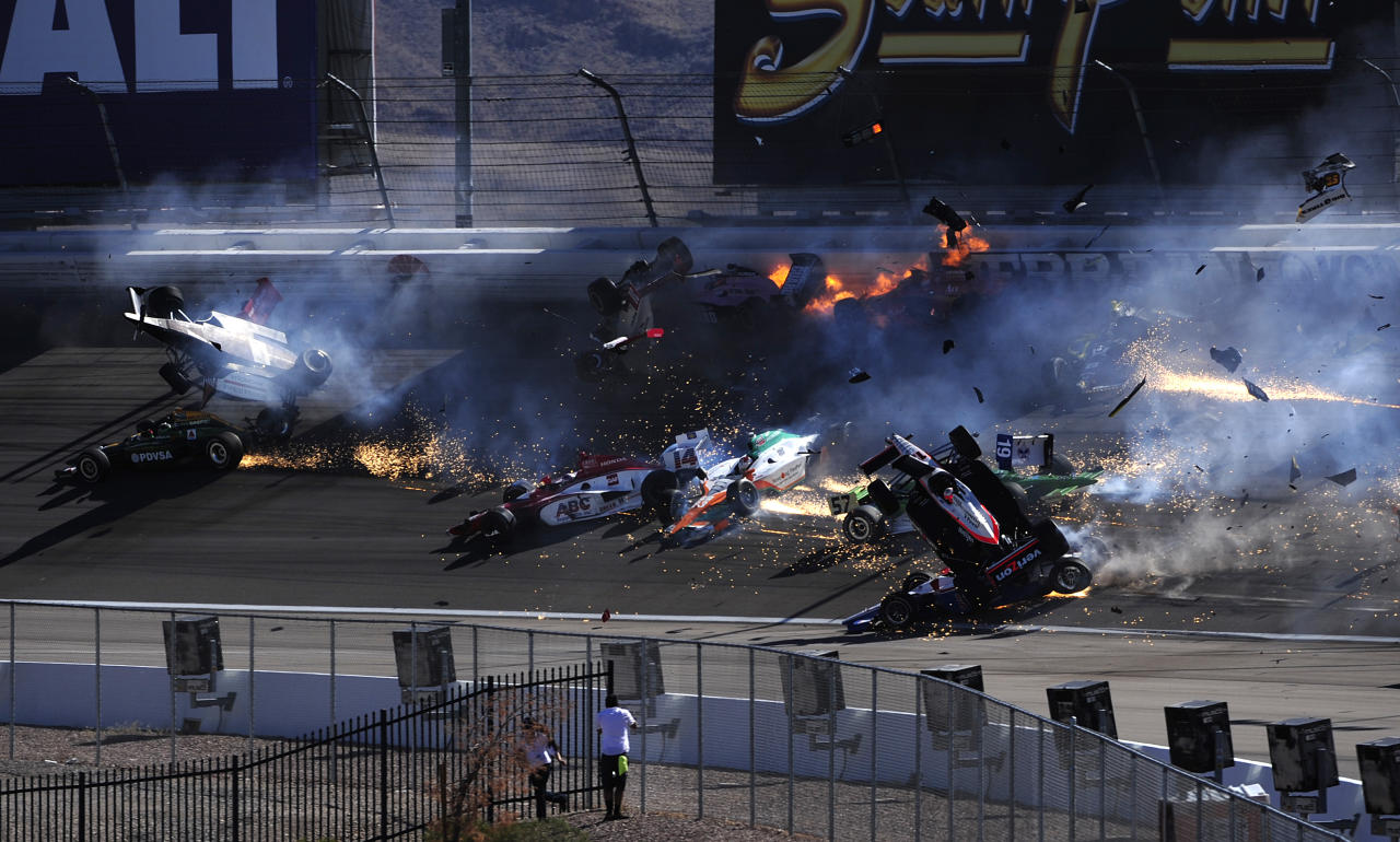LAS VEGAS - SEPTEMBER 16:  The car of Dan Wheldon driver of the #77 Bowers & Wilkins Sam Schmidt Motorsports Dallara Honda (top left) bursts into flames in a 15 car pile up including the #12 Team Penske Dallara Honda of Will Power during the Las Vegas Indy 300 part of the IZOD IndyCar World Championships presented by Honda on September 16, 2011 at the Las Vegas Motor Speedway in Las Vegas, Nevada.  (Photo by Robert Laberge/Getty Images)