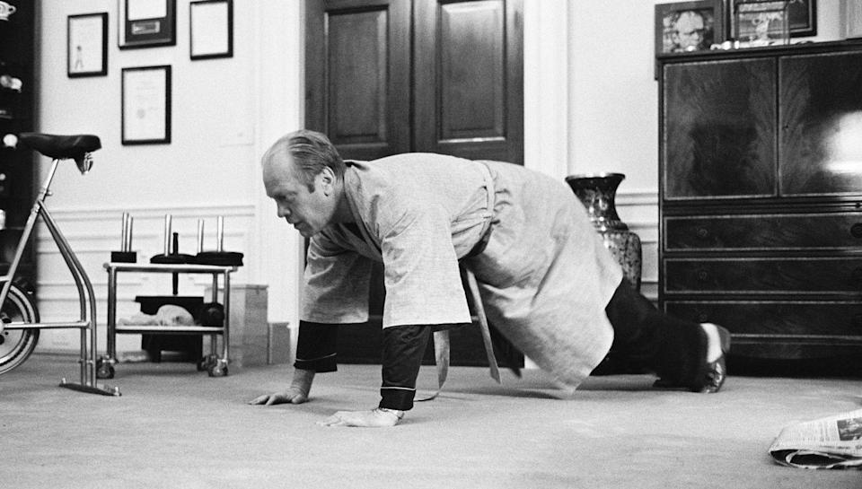 <p>Gerald R. Ford does push-ups in his PJs in the White House in 1975. </p>