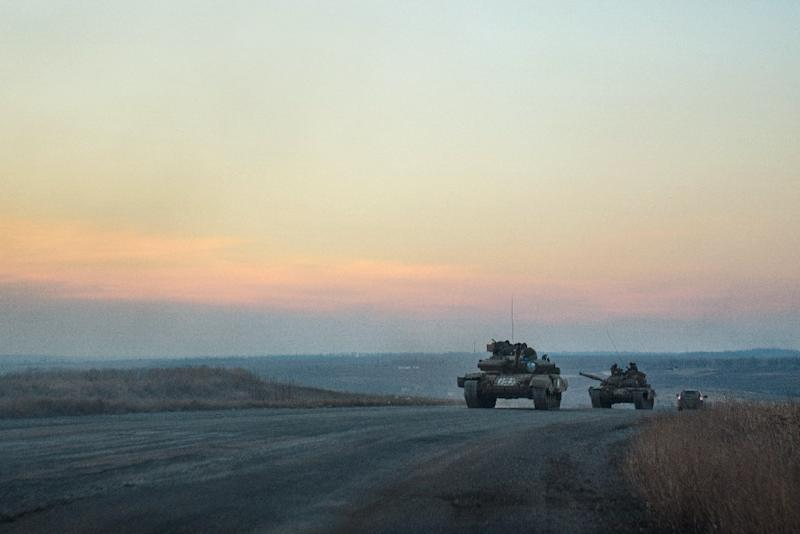 Pro-Russian separatists tanks roll down the road from Donetsk to Novoazovsk, Mariupol district, on February 24, 2015 (AFP Photo/Andrey Borodulin)