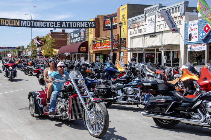 FILE - In this Aug. 15, 2020 file photo, bikers ride down Main Street during the 80th annual Sturgis Motorcycle Rally in Sturgis, S.D. According to a Friday, Nov. 20, report from the Centers for Disease Control and Prevention the summer's huge motorcycle rally in South Dakota led to dozens of coronavirus cases in neighboring Minnesota. (Amy Harris/Invision/AP)