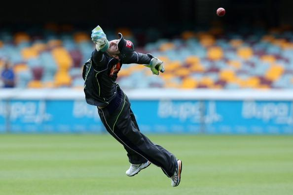BRISBANE, AUSTRALIA - NOVEMBER 06:  Matthew Wade dives for a catch during an Australian training session at The Gabba on November 6, 2012 in Brisbane, Australia.  (Photo by Chris Hyde/Getty Images)