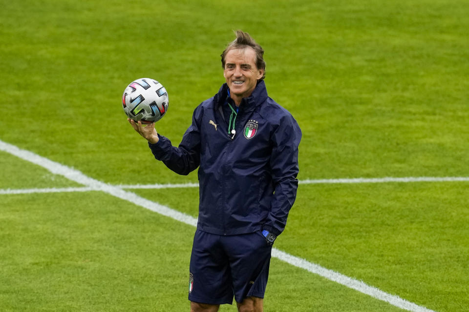 Italy's manager Roberto Mancini smiles during a training session at the Hive stadium in London, England, Monday, July 5, 2021, ahead of their Euro 2020 soccer championship semifinal match against Spain.(AP Photo/Matt Dunham)