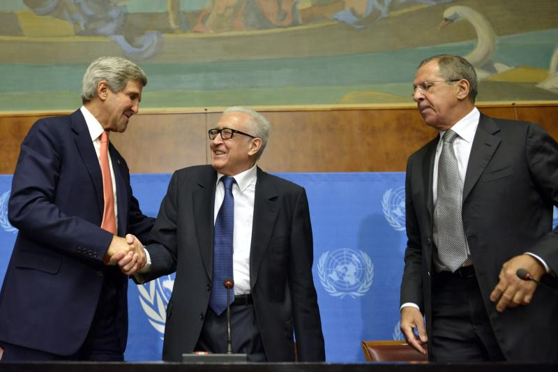 "John Kerry, left, US Secretary of State, shakes hands with Lakhdar Brahimi, center, UN Joint Special Representative for Syria, next to Sergei Lavrov, right, Russian Foreign Minister during a press conference after their meeting at the European headquarters of the United Nations in Geneva, Switzerland, Friday, Sept. 13, 2013. Kerry and Lavrov say the prospects for a resumption in the Syria peace process are riding on the outcome of their chemical weapons talks. Kerry, flanked by Lavrov and Brahimi, told reporters after an hour-long meeting that the chances for a second peace conference in Geneva ""will obviously depend on the capacity to have success here ... on the subject of the chemical weapons."" (AP Photo/Keystone, Martial Trezzini)"