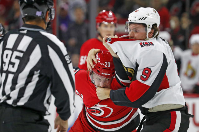 Carolina Hurricanes' Brock McGinn (23) and Ottawa Senators' Bobby Ryan (9) exchange blows during the first period of an NHL hockey game in Raleigh, N.C., Monday, Nov. 11, 2019. (AP Photo/Karl B DeBlaker)