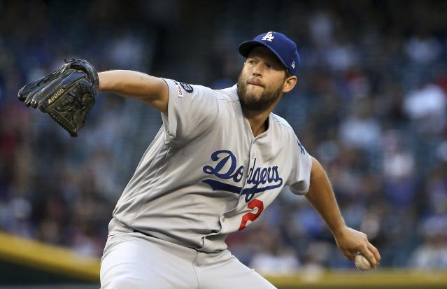 Los Angeles Dodgers starting pitcher Clayton Kershaw throws against the Arizona Diamondbacks during the first inning of a baseball game Monday, June 24, 2019, in Phoenix. (AP Photo/Ross D. Franklin)
