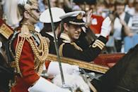 <p>Prince Charles waves to the excited crowds along the processional—an appropriate response to the many people who camped out ahead of his wedding, if you ask us.</p>