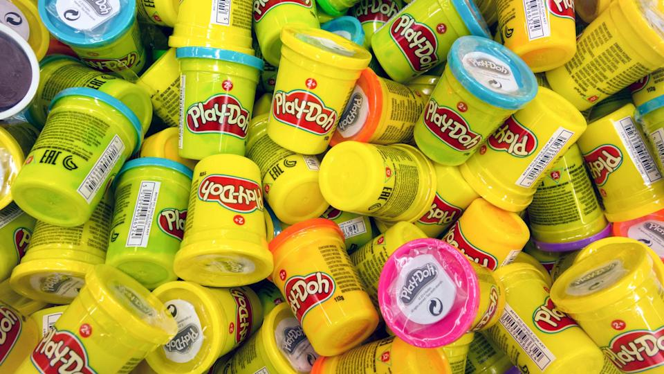 Paphos, Cyprus - October 18, 2016 Heap of Play-Doh containers with difrent color modeling compound.