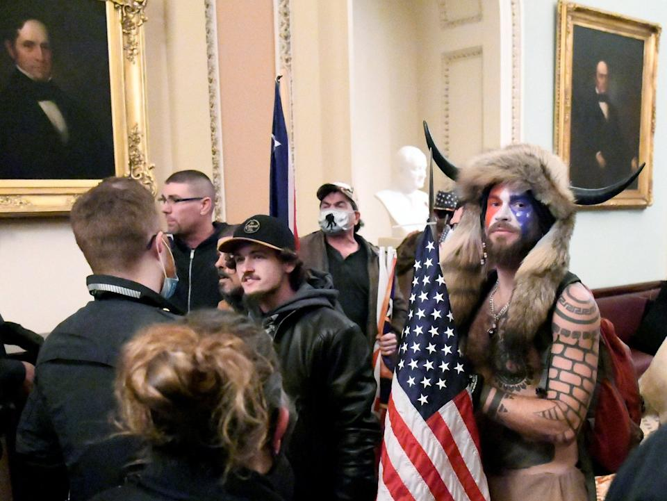 <p>Trump supporters breach the US Capitol</p> (Reuters)