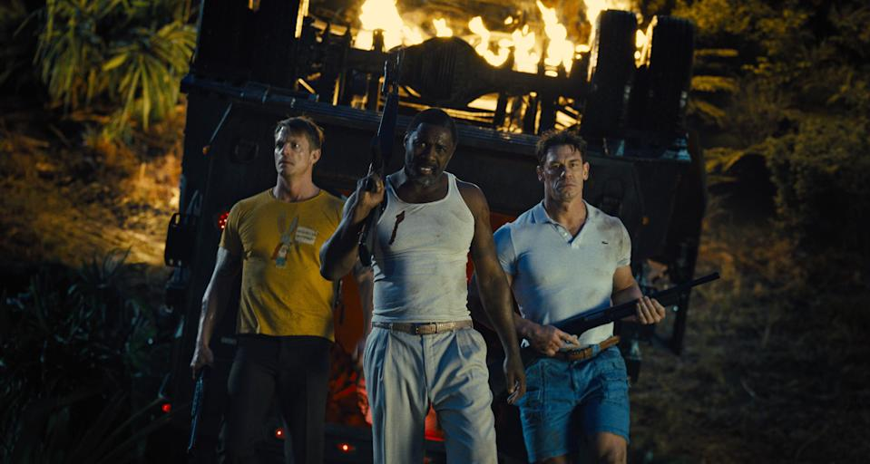 """Rick Flag (Joel Kinnaman, left), Bloodsport (Idris Elba) and Peacemaker (John Cena) go undercover during a dangerous mission in """"The Suicide Squad."""""""