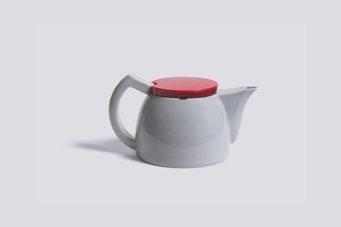 """This designer teapot is made of porcelain, stainless steel, and plastic, and holds one liter of liquid. $95, HAY. <a href=""""https://us.hay.com/accessories/by-room/kitchen/sowden-tea-pot/2515073.html"""" rel=""""nofollow noopener"""" target=""""_blank"""" data-ylk=""""slk:Get it now!"""" class=""""link rapid-noclick-resp"""">Get it now!</a>"""