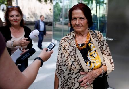 "A member of ""Mothers of Srebrenica"" association talks with the media as she waits for the ruling on the case brought by relatives of the victims of the 1995 Srebrenica massacre, at the Dutch high court in The Hague"