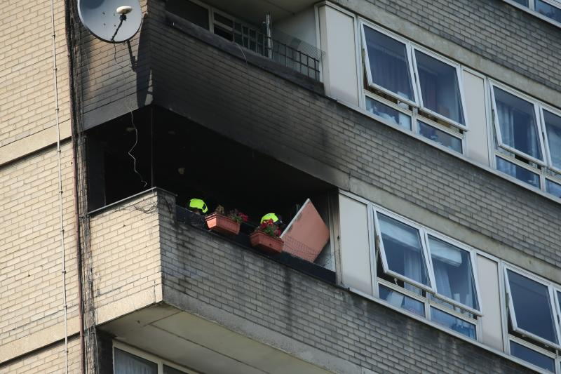 London Fire Brigade personnel attend the scene of a fire at a residential tower block Markland House in West London on August 23, 2019. - A fire broke out on August 23 at a block of flats a short distance away from Grenfell Tower in west London. London fire Brigade firecrews attended the scene and brought the fire under control with no reported casualties. (Photo by Isabel Infantes / AFP) (Photo credit should read ISABEL INFANTES/AFP/Getty Images)