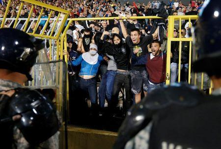 Fans of Serbia confront the riot police during the Euro 2016 Group I qualifying soccer match between Serbia and Albania at the FK Partizan stadium in Belgrade October 14, 2014. REUTERS/Marko Djurica