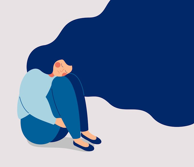 Sad lonely Woman in depression with flying hair. Young unhappy girl sitting and hugging her knees. Depressed teenager. Colorful vector illustration in flat cartoon style (Photo: Ponomariova_Maria via Getty Images)