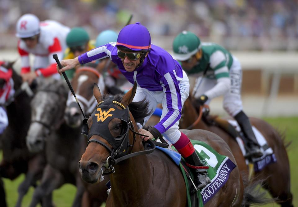 Frankie Dettori celebrates after riding Hootenanny to victory in the Breeders' Cup Juvenile Turf horse race at Santa Anita Park, Friday, Oct. 31, 2014, in Arcadia, Calif. (AP Photo/Mark J. Terrill)