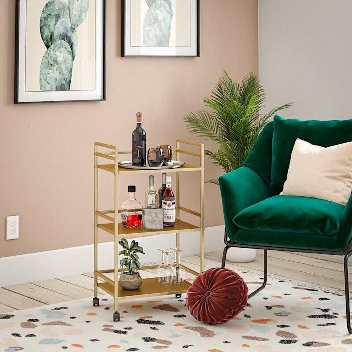 """Just don't let it tip over when you're feeling tipsy. And you can store everything from plants to books on it, too. <a href=""""https://fave.co/3bN0Olf"""" rel=""""nofollow noopener"""" target=""""_blank"""" data-ylk=""""slk:Find it on sale for $65 at Wayfair"""" class=""""link rapid-noclick-resp"""">Find it on sale for $65 at Wayfair</a>."""