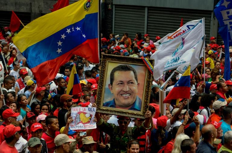 Supporters of Venezuelan President Nicolas Maduro take part in a rally against the secretary general of the Organization of American States (OAS), Luis Almagro, in Caracas, on March 28, 2017