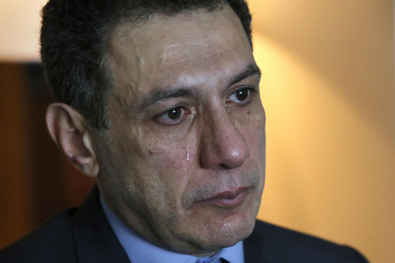 "Nizar Zakka a Lebanese citizen and permanent U.S. resident who was released in Tehran after nearly four years in jail on charges of spying, cries during an interview with The Associated Press at a hotel in Dbayeh, north of Beirut, Lebanon, Wednesday, June 12, 2019. Zakka, an information technology expert, who was detained in Iran in September 2015 while trying to fly out of Tehran called on President Donald Trump to ""get back your hostages"" from Iran. He was sentenced to 10 years in prison after authorities accused him of being an American spy - allegations vigorously rejected by Zakka, his family and associates. (AP Photo/Bilal Hussein)"