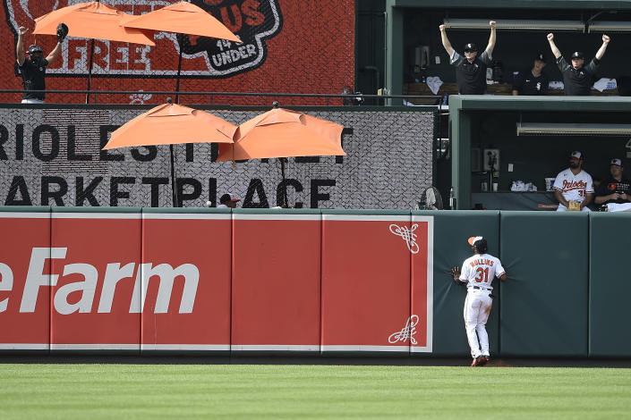 Baltimore Orioles center fielder Cedric Mullins hits the wall after chasing down a three run home run by Chicago White Sox Adam Engel In the 10th inning of a baseball game, July 11, 2021 in Baltimore. (AP Photo/Gail Burton)