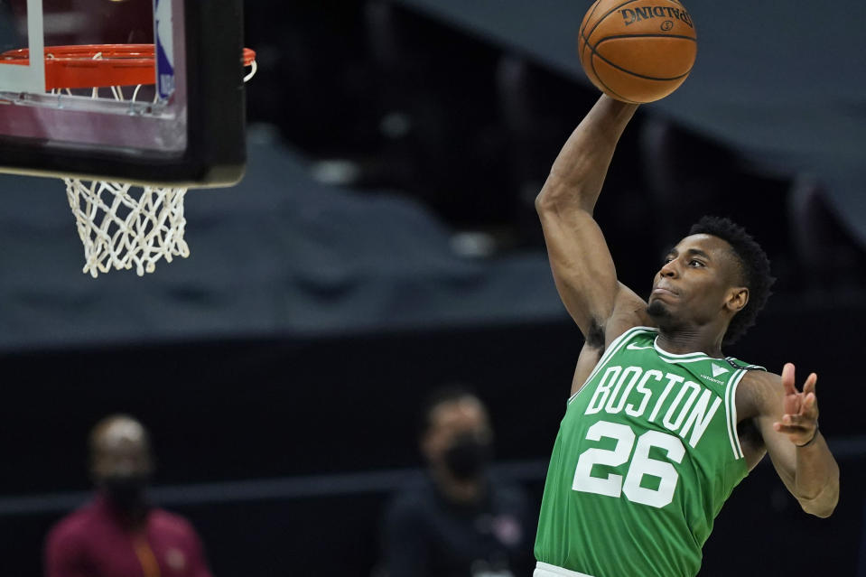 Boston Celtics' Aaron Nesmith goes up for a dunk during the first half of the team's NBA basketball game against the Cleveland Cavaliers, Wednesday, May 12, 2021, in Cleveland. (AP Photo/Tony Dejak)
