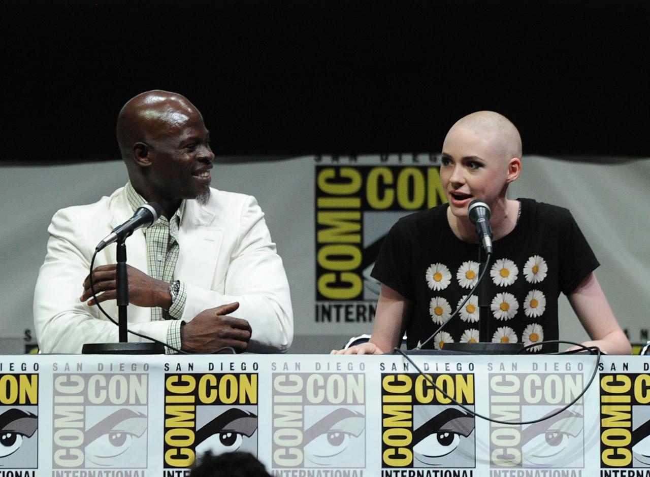 "SAN DIEGO, CA - JULY 20: Actors Djimon Hounsou (L) and Karen Gillan speak onstage at Marvel Studios ""Guardians of the Galaxy"" during Comic-Con International 2013 at San Diego Convention Center on July 20, 2013 in San Diego, California. (Photo by Kevin Winter/Getty Images)"
