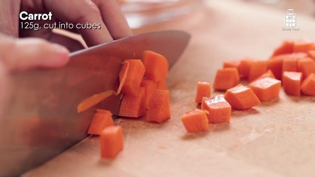 Chopping carrots into small pieces