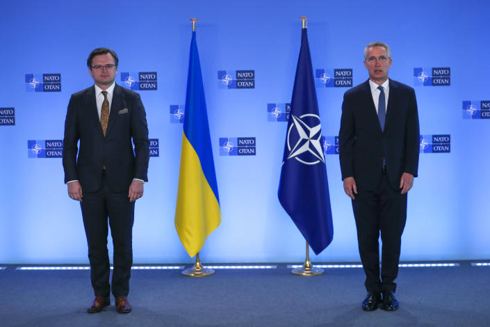 NATO Secretary General Jens Stoltenberg, right, and Ukraine's Foreign Minister Dmytro Kuleba pose for photographers prior to a meeting at NATO headquarters in Brussels, Tuesday, April 13, 2021. (AP Photo/Francisco Seco, Pool)