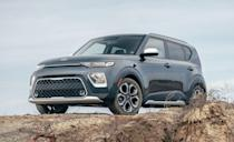 """<p>The <a href=""""https://www.caranddriver.com/kia/soul"""" rel=""""nofollow noopener"""" target=""""_blank"""" data-ylk=""""slk:Kia Soul"""" class=""""link rapid-noclick-resp"""">Kia Soul</a>'s body is proportioned like an ice-cold tall boy. But that tall stature gives it the most cargo volume in the segment, with 62 cubic feet of available space. The Soul also has the lowest base price on the list. We fit 20 carry-ons, which is only two short of what we were able to fit in the larger <a href=""""https://www.caranddriver.com/kia/sportage"""" rel=""""nofollow noopener"""" target=""""_blank"""" data-ylk=""""slk:Sportage"""" class=""""link rapid-noclick-resp"""">Sportage</a>. It doesn't have quite as much room behind the rear seats as the Seltos, but its starting price is $4400 lower.</p><ul><li>Base price: $18,765</li><li>Carry-on capacity, rear seats folded: 20 suitcases</li><li>Cargo volume, rear seats folded: 62 cubic feet<br></li><li>Cargo volume, behind rearmost row of seats: 24 cubic feet<br></li></ul><p><a class=""""link rapid-noclick-resp"""" href=""""https://www.caranddriver.com/kia/soul/specs"""" rel=""""nofollow noopener"""" target=""""_blank"""" data-ylk=""""slk:MORE SOUL SPECS"""">MORE SOUL SPECS</a></p>"""