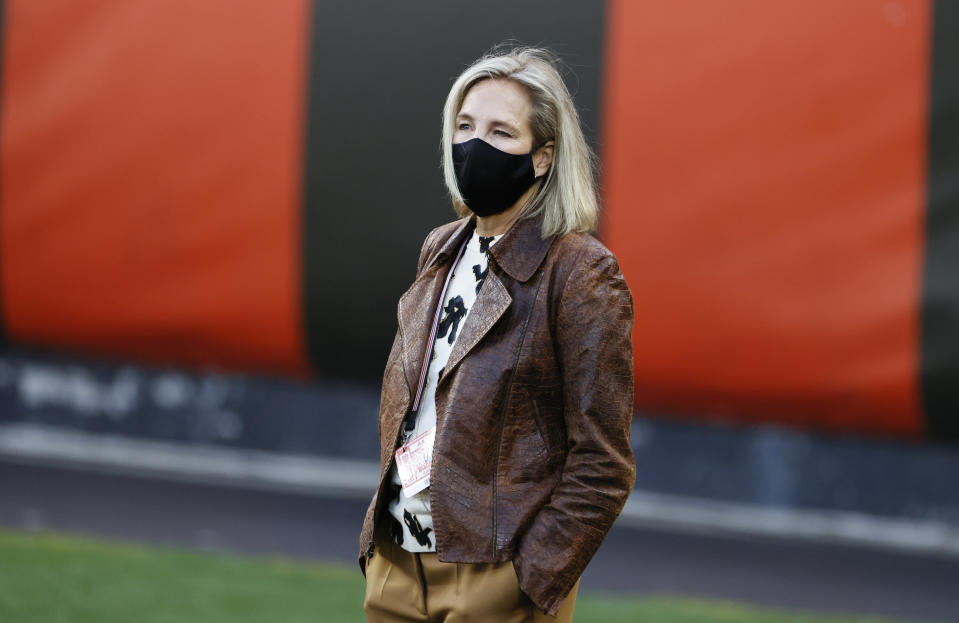 """FILE - In this Sept. 17, 2020, file photo, Cleveland Browns co-owner Dee Haslam walks the field before the team's NFL football game against the Cincinnati Bengals in Cleveland. """"We're seeing more and more women that love the sport and who want a career in sports,"""" Haslam said last month. """"The door has swung wide open and I am so excited. I look forward to the moment when we don't have to talk about how we get the door open for women and people of color, that the door is wide open."""" (AP Photo/Ron Schwane, File)"""