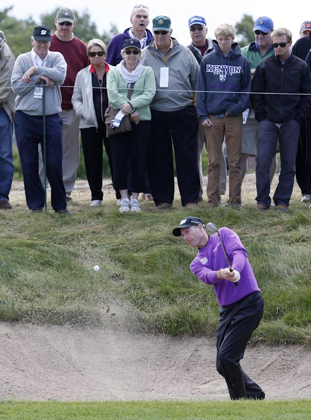 Jim Furyk hits out of the sand on the third hole during the final round of the BMW Championship golf tournament at Conway Farms Golf Club in Lake Forest, Ill., Monday, Sept. 16, 2013. (AP Photo/Charles Rex Arbogast)