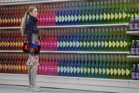 """A model presents a creation by German designer Karl Lagerfeld as part of his Fall/Winter 2014-2015 women's ready-to-wear collection for French fashion house Chanel at the Grand Palais transformed into a """"Chanel Shopping Center"""" during Paris Fashion Week March 4, 2014. REUTERS/Stephane Mahe"""