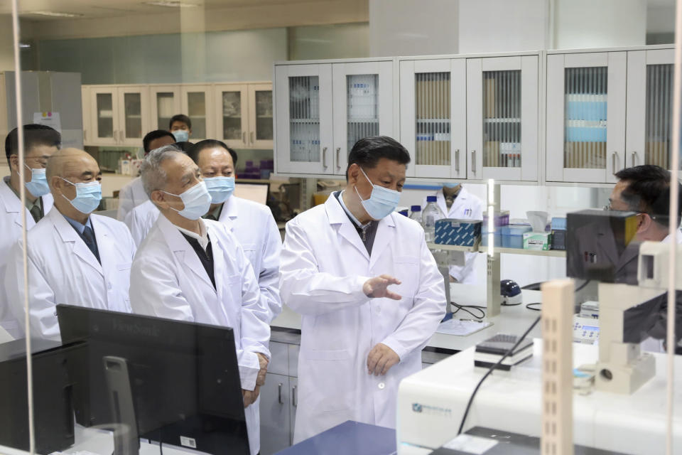 """In this March 2, 2020, photo released by Xinhua News Agency, Chinese President Xi Jinping learns about the progress on the research into COVID-19 vaccine candidates during a visit to the Academy of Military Medical Sciences in Beijing. With national pride at stake in the global race for a coronavirus vaccine, Xi pledged that any Chinese-made vaccine would be a """"global public good."""" (Ding Haitao/Xinhua via AP)"""