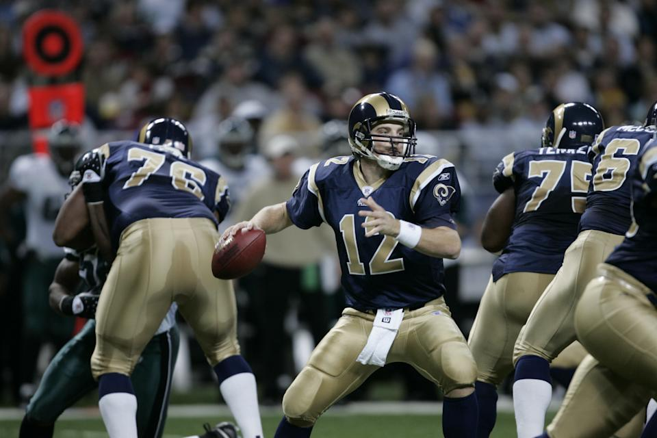 ST. LOUIS - DECEMBER 18:  Ryan Fitzpatrick #12 of the Philadelphia Eagles drops back to pass during the game with the St. Louis Rams at the Edward Jones Dome on December 18, 2005 in St. Louis, Missouri. The Eagles won 17-16. (Photo by Dilip Vishwanat/Getty Images)