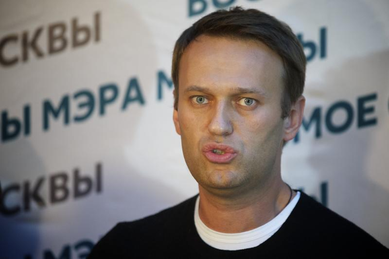 Russian opposition leader Alexei Navalny speaks to the media at his headquarters in Moscow, Russia, Sunday, Sept. 8, 2013. Two exit polls in Moscow's mayoral election are predicting a stronger showing than expected for opposition leader Alexei Navalny. Sunday's mayoral election is a potentially pivotal contest that has energized the small opposition in ways that could pose a risk to the Kremlin in the days and years ahead. (AP Photo/Alexander Zemlianichenko)